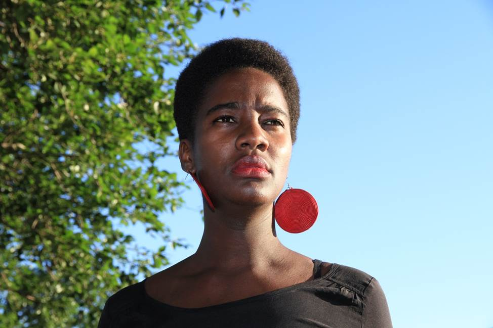 African Woman with red earrings