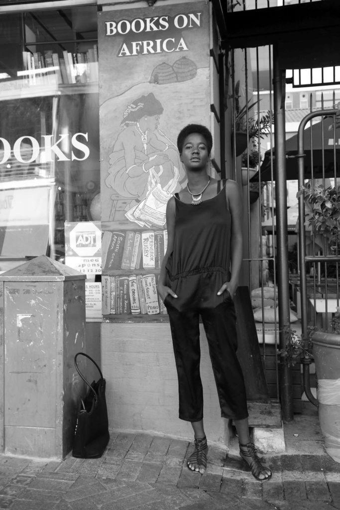 Portrait Photography African Woman in front of a bookstore Fashion